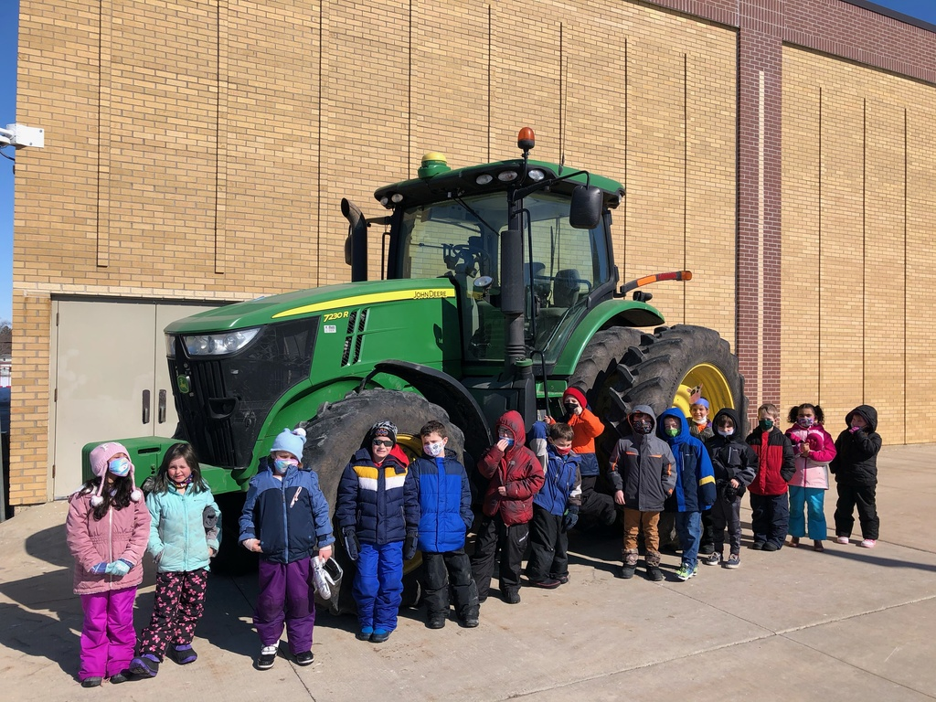 Mrs. Nolen's Class by the tractor